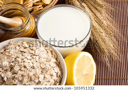 oatmeal and milk on wood background - stock photo