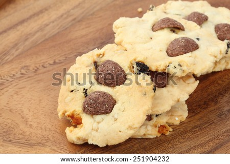oatmeal and raisins cookies on wood background