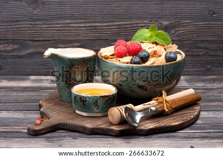 Oatmeal cereal with milk, honey and berries. Healthy food. - stock photo
