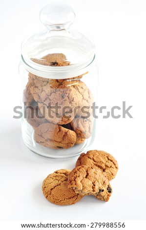 Oatmeal cookie in a glass jar - stock photo