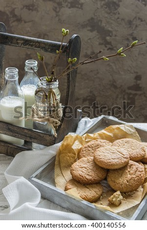 Oatmeal cookies and milk with wooden background. - stock photo