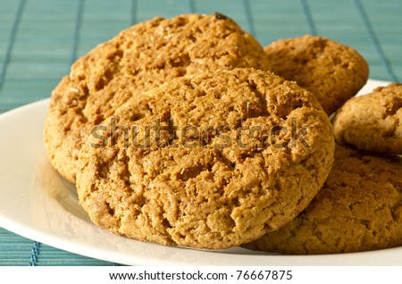 oatmeal cookies lay on a plate