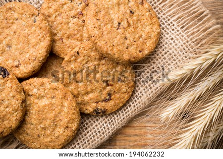 Oatmeal cookies on a wooden background. Studio photography.
