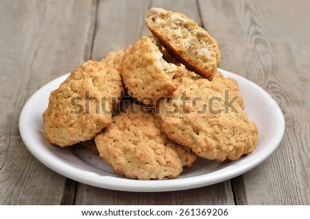 Oatmeal cookies on wooden table, close up view - stock photo