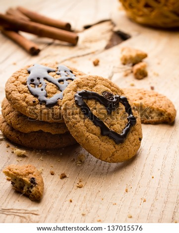 Oatmeal cookies with chocolate heart shape. - stock photo