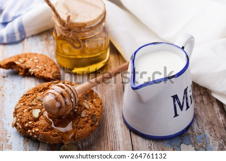 Oatmeal cookies with honey and milk.selective focus - stock photo
