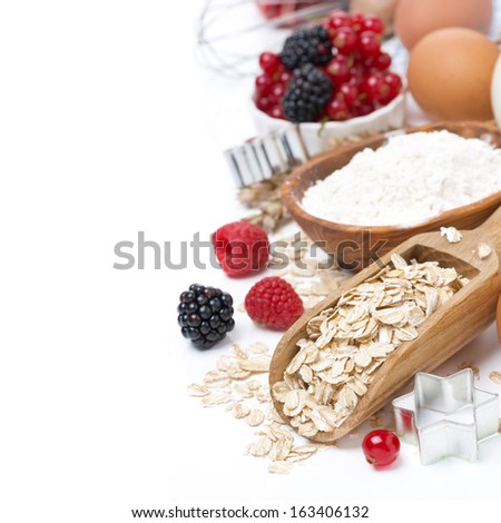 oatmeal, flour, eggs and berries - the ingredients for baking cookies, close-up - stock photo