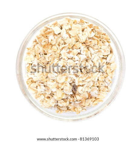 oatmeal in a glass bowl isolated on white - stock photo