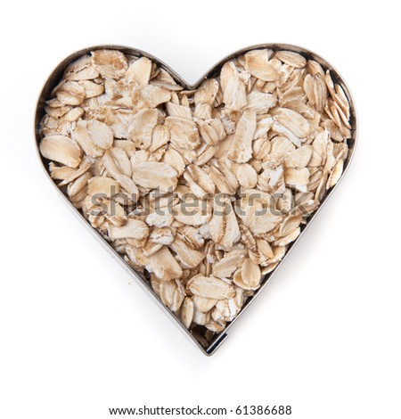 Oatmeal in a heart-shaped cookie cutter. - stock photo