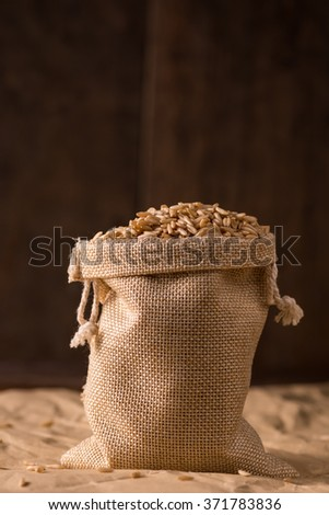 Oatmeal in small burlap sack
