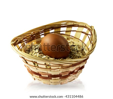 Oatmeal porridge and egg in wicker basket close up on white isolated background