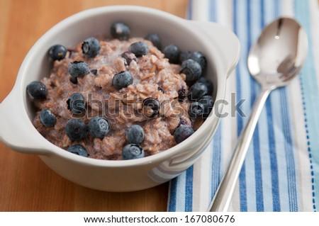 Oatmeal porridge with blueberry  - stock photo