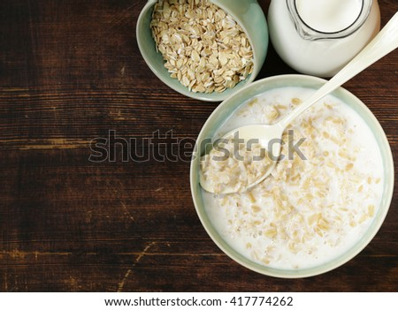 oatmeal porridge with milk - healthy breakfast - stock photo