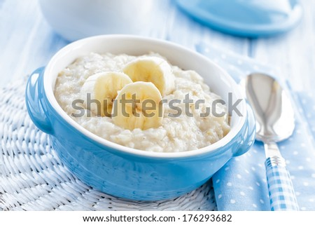 Oatmeal with banana - stock photo
