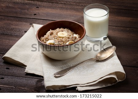 Oatmeal with flax seeds and banana - stock photo