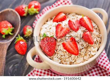 Oatmeal with strawberries - stock photo