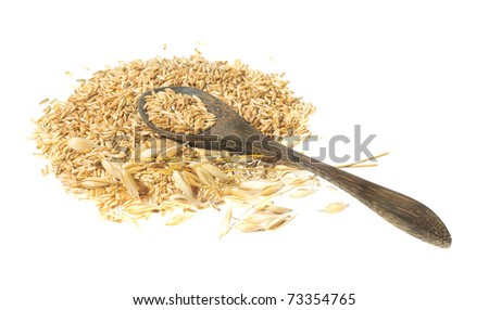 Oats grains and ears isolated on white background. Wooden spoon with pile of oat seeds. - stock photo