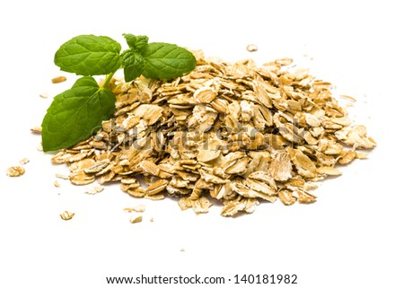 Oats pile with mint branch - stock photo