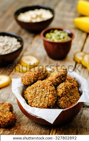 oats pumpkin and sunflower seeds banana cookies. gluten-free. toning. selective focus - stock photo