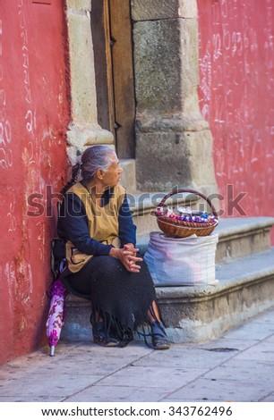OAXACA , MEXICO - NOV 02 : A street vendor in Oaxaca Mexico on November 02 2015. the Historic Center of Oaxaca is an UNESCO World Heritage Site since 1987 - stock photo