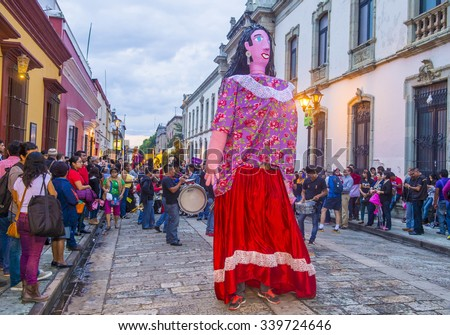 OAXACA , MEXICO  - NOV 02 : Mojiganga at the carnival of the Day of the Dead in Oaxaca, Mexico, on November 02 2015. Mojigangas are traditional Mexican giant puppets. - stock photo