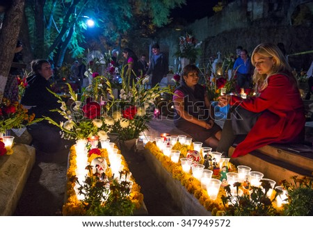OAXACA , MEXICO - NOV 02 : Unidentified people on a cemetery during Day of the Dead in Oaxaca, Mexico on November 02 2015. The Day of the Dead is one of the most popular holidays in Mexico - stock photo