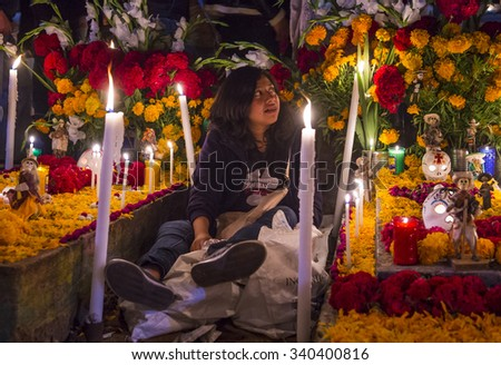 OAXACA , MEXICO - NOV 02 : Unidentified woman on a cemetery during Day of the Dead in Oaxaca, Mexico on November 02 2015. The Day of the Dead is one of the most popular holidays in Mexico - stock photo