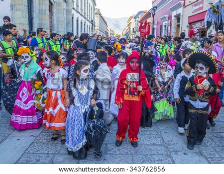 OAXACA , MEXICO  - NOV 02 : Unknown participants on a carnival of the Day of the Dead in Oaxaca, Mexico, on November 02 2015. The Day of the Dead is one of the most popular holidays in Mexico - stock photo