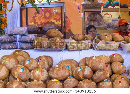 OAXACA , MEXICO - NOV 02 : Women selling traditional Mexican Bread called Bread of the Dead in Oaxaca market on November 02 2015. this bread eaten during Day of the Dead festivities in Mexico. - stock photo