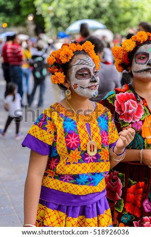 OAXACA, MEXICO - OCT 31, 2016: Unidentified girl dressed and painted for the Day of the Dead (Dia de los Muertos), national Mexican holiday, UNESCO Intangible Cultural Heritage of Humanity