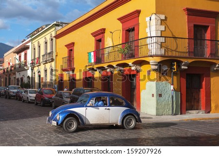 OAXACA, MEXICO - SEN 16: Old cars on the street of Oaxaca, Mexico, 16 September 2012. The city architecture of Oaxaca is protected by UNESCO - stock photo