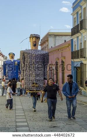 OAXACA, OAXACA, MEXICO- MARCH 21, 2016: Marmotas (giant puppets) at the street in Oaxaca, Mexico. - stock photo