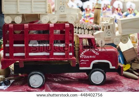 OAXACA, OAXACA, MEXICO- MARCH 21, 2016 Wooden red toy car. Handicraft from Oaxaca, Mexico - stock photo