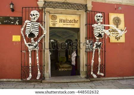 OAXACA, OAXACA, MEXICO- NOVEMBER 2, 2015: Giant skeletons outside of a store in Oaxaca, Mexico - stock photo