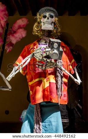 OAXACA, OAXACA, MEXICO- NOVEMBER 2, 2015: Skull dressed as a tourist at the day of the dead in Oaxaca, Mexico - stock photo