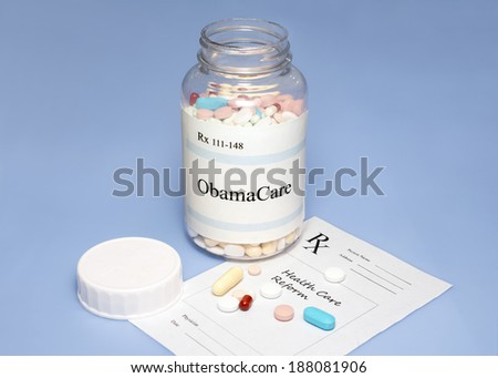 ObamaCare assorted pills on blue background with prescription for healthcare reform. - stock photo