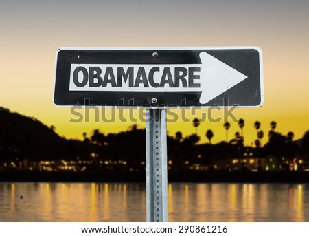 Obamacare direction sign with sunset background - stock photo