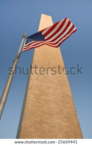 obelisk and waving american flag, - stock photo