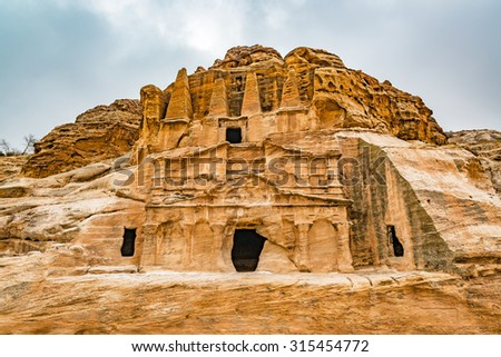 Obelisk tombs in the ancient city of Petra, Jordan. Petra has led to its designation as a UNESCO World Heritage Site. - stock photo