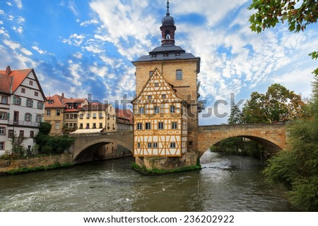 Obere bridge (br���¼cke) and Altes Rathaus and cloudy sky in Bamberg, Germany