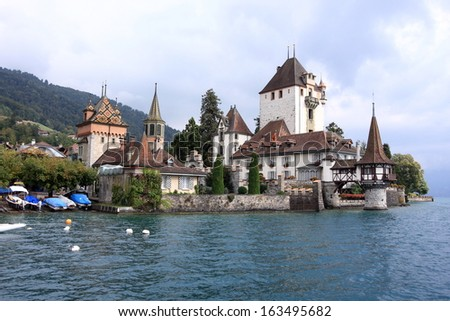 Oberhofen castle on the shore of Lake Thun of Jungfrau region in Switzerland