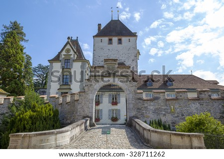 OBERHOFEN, SWITZERLAND - SEPTEMBER 08, 2015: Main entry to Castle of Oberhofen. The castle dates back to the history of the 13th century. Nowadays the Historic Museum opened to the public since 1954 - stock photo