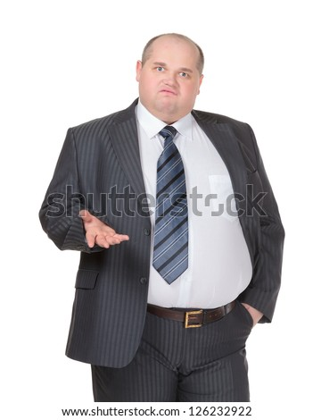 Obese businessman in a suit and tie standing facing the camera making a point with one hand in his pocket while gesturing with the other, isolated on white - stock photo