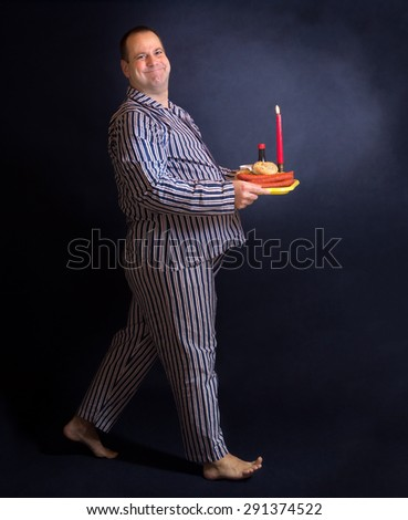Obese man carries a tray of food - stock photo