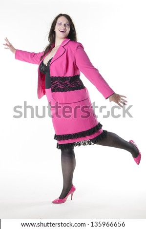 Obese woman with long dark hair wearing a pink costume with joy Oversized, isolated against white background.