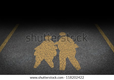 Obesity in children and childhood obese concept with a yellow painted asphalt road sign as an icon of overweight kids and students as a warning to the hazards of eating junk food and fatty fast food. - stock photo