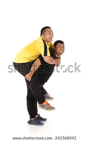 Obesity man carrying his friend at the back - stock photo