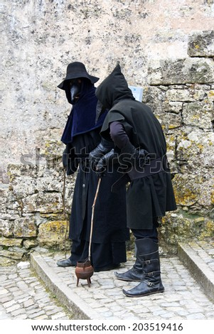 OBIDOS, PORTUGAL - MAY 7, 2013 : Street performers provide insight on a city street.
