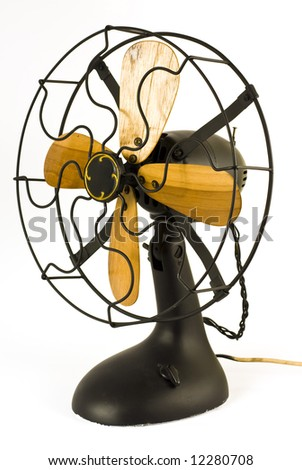 Object Shot of a classy vintage electric fan isolated against white - stock photo