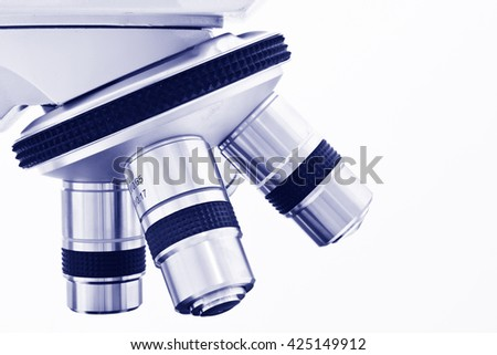 Objective Lens of Microscope Isolated on the White Background